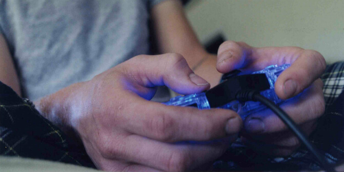 closeup of hand handling a video game controller